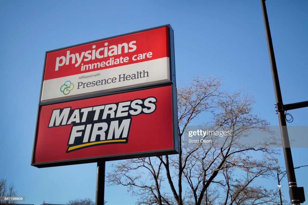 A sign hangs outside a Mattress Firm store on December 6, 2017 in Chicago, Illinois. Steinhoff International Holdings N.V., which is the parent company of Mattress Firm, saw its stock value plummet more than 60 percent today after the resignation of CEO Markus Jooste and an announcement from the company that it was launching an investigation into accounting irregularities