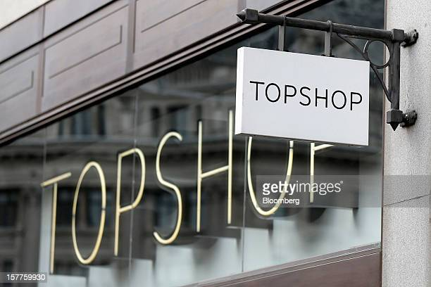A sign hangs outside a Topshop store owned by Arcadia Group Ltd on Oxford Street in London UK on Thursday Dec 6 2012 Philip Green the billionaire...