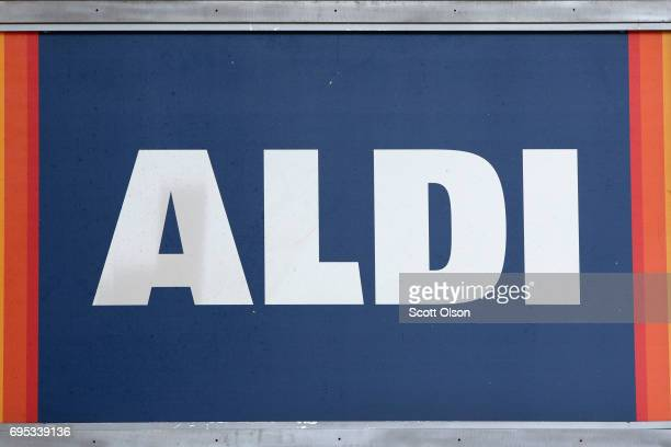 A sign hangs outside an Aldi grocery store on June 12 2017 in Chicago Illinois Aldi has announced plans to open 900 new stores in the United States...