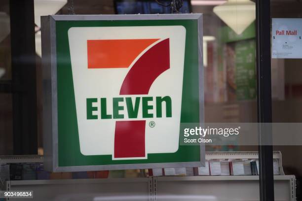 A sign hangs outside of a 7Eleven store on January 10 2018 in Chicago Illinois Immigration officials raided nearly 100 7Eleven stores across the...