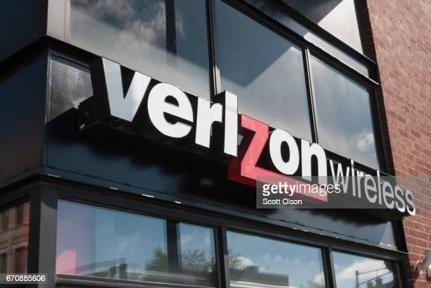 A sign hangs outside of a Verizon store on April 20 2017 in Chicago Illinois In the first three months of the year Verizon wireless revenue fell 5...