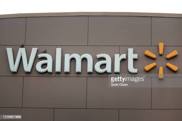 Sign hangs outside of a Walmart store on May 19, 2020 in Chicago, Illinois. Walmart reported a 74% increase in U.S. Online sales for the quarter that...
