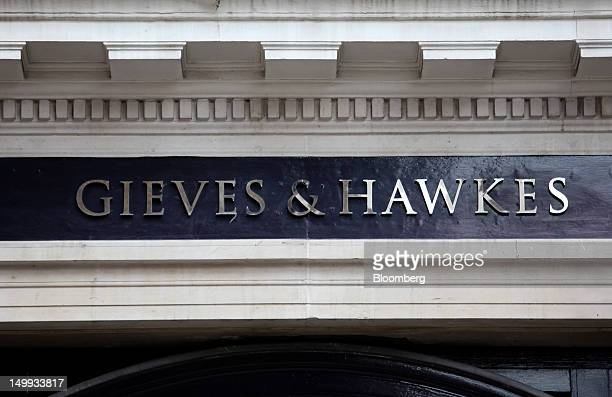 A sign hangs outside the Gieves Hawkes store owned by Trinity Ltd on Saville Row in London UK on Tuesday Aug 7 2012 UK retail sales rose in July as...