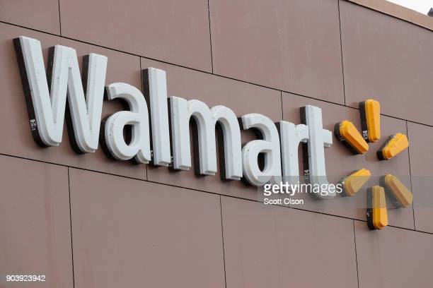 Sign hangs outside Walmart store on January 11, 2018 in Chicago, Illinois. Walmart announced today it would use savings from the recently revised tax...