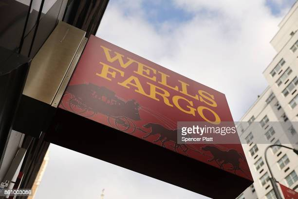 A sign hangs over a Wells Fargo bank branch on October 13 2017 in New York City Wells Fargo shares were down 34% toÊ$5334Êin afternoonÊtrading...