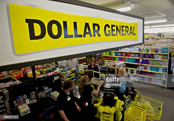A sign hangs over cash registers at a Dollar General Corp store in Creve Coeur Illinois US on Thursday May 31 2012 US consumer spending rose in April...