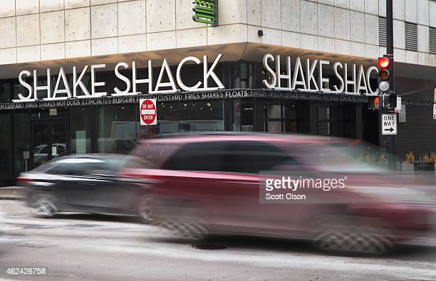 Sign hangs over the entrance of a Shake Shack restaurant on January 28, 2015 in Chicago, Illinois. The burger chain, with currently has 63 locations,...