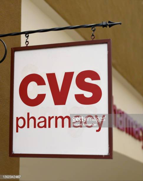 A sign hangs over the entrance to a CVS pharmacy in Santa Fe New Mexico