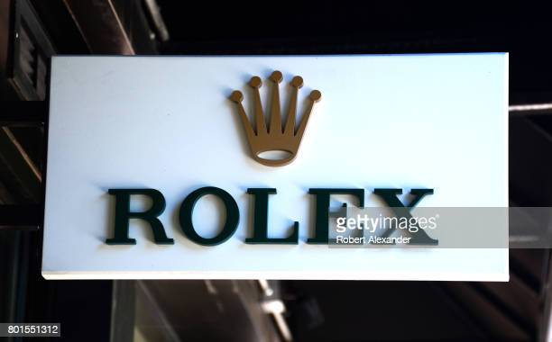 A sign hangs over the entrance to a Rolex shop in Aspen Colorado The Swiss luxury watchmaker is based in Geneva Switzerland