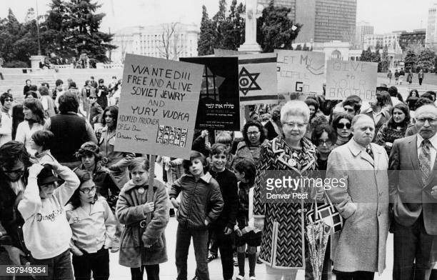 """Sign held by boy, foreground, relates East Denver Orthodox Synagogue's """"adoption"""" of Yury Vudka, a Soviet Jew reportedly imprisoned in the Soviet..."""