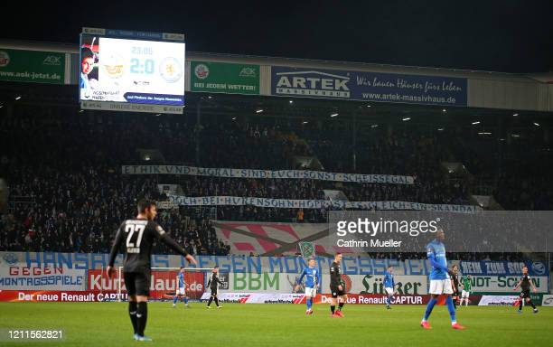 Sign held up by Rostock supporters during the 3 Liga match between Hansa Rostock and Eintracht Braunschweig at Ostseestadion on March 09 2020 in...