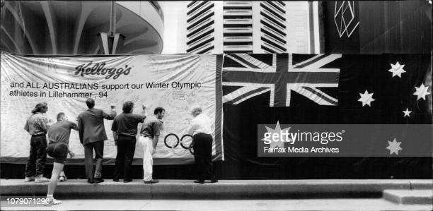 Sign here Sydney siders had their chance to wish Australia's winter Olympics team good luck by writing their messages of support on a giant...