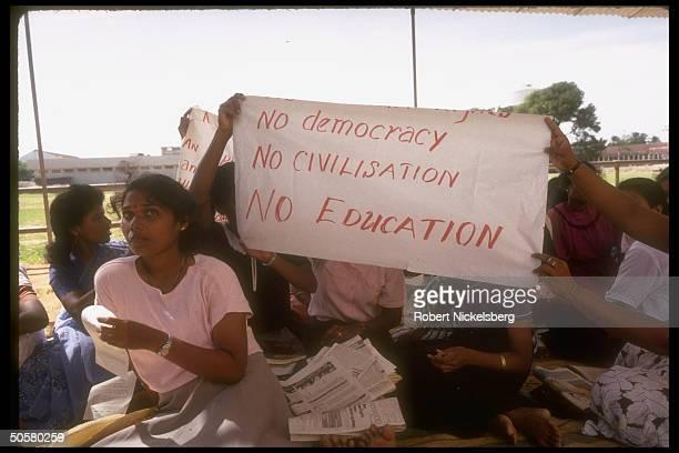 Sign holding Univ. Of Jaffna students protesting, staging strike after death of faculty member in Tamil rebel war torn Sri Lanka.