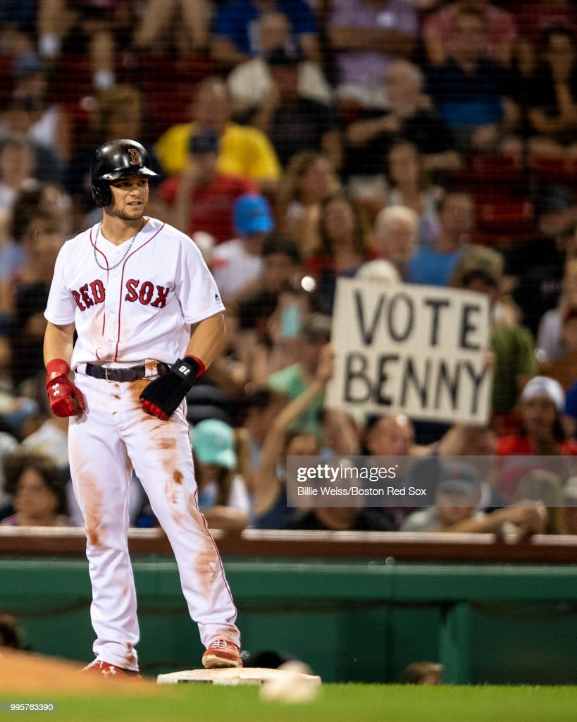 A sign holds a fan as Andrew Benintendi #16 of the Boston Red Sox reacts after stealing third base during the seventh inning of a game against the Texas Rangers on July 10, 2018 at Fenway Park in Boston, Massachusetts.