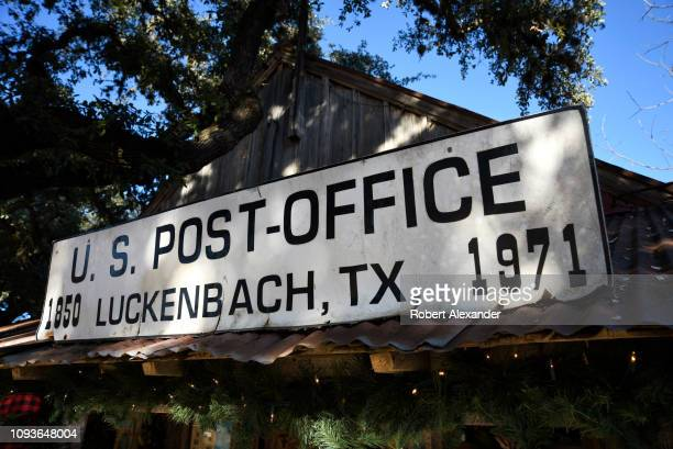 A sign identifies a building which served as a US post office between 1850 and 1971 before it and surrounding land was coverted into a general store...