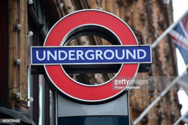 A sign identifies the entrance to the Knightsbridge underground station near Harrods department store in London England
