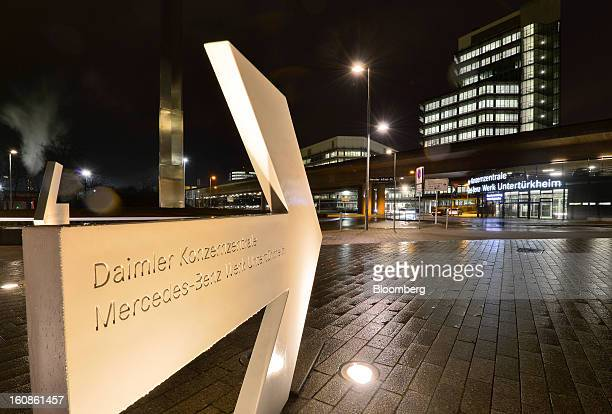 A sign illuminated at night points to the entrance of the Daimler AG headquarters and the MercedesBenz plant in Stuttgart Germany on Wednesday Feb 6...