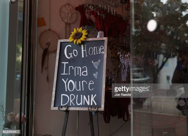 A sign in a business reads 'Go Home Irma Youre Drunk' as people prepare for the arrival of Hurricane Irma on September 6 2017 in Miami Florida It's...
