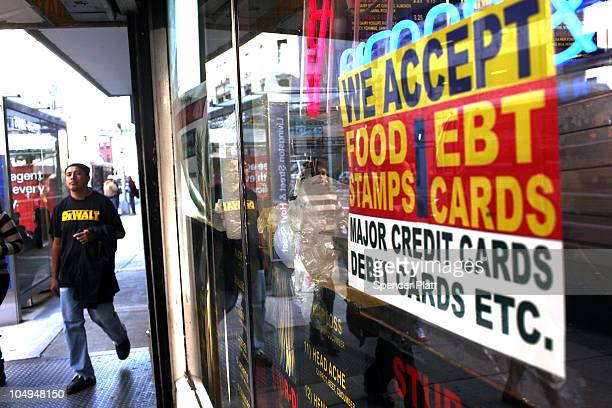 A sign in a market window advertises the acceptance of food stamps on October 7 2010 in New York City New York Mayor Michael Bloomberg is proposing...