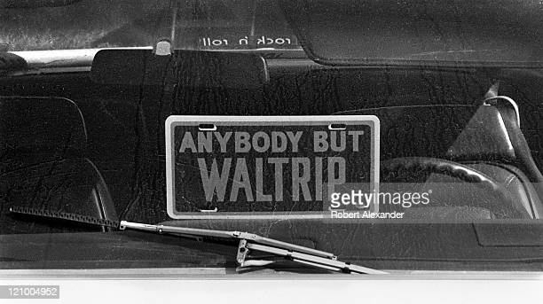 A sign in a pickup truck window parked in the Daytona International Speedway infield during the 1982 Daytona 500 expresses the owner's displeasure...