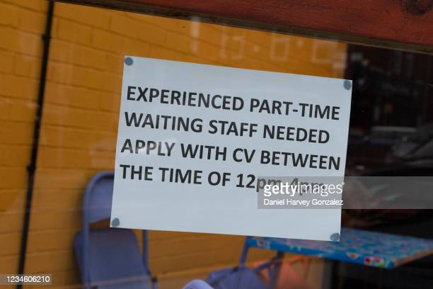 Sign in a restaurant window advertises a vacancy for experienced part-time waiting staff as British employers face the worst labour shortage since...