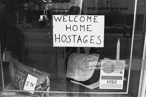 A sign in a store window in Miami Beach Florida proclaiming 'Welcome Home Hostages' 25th January 1981 It refers to the end of the Iran hostage crisis...