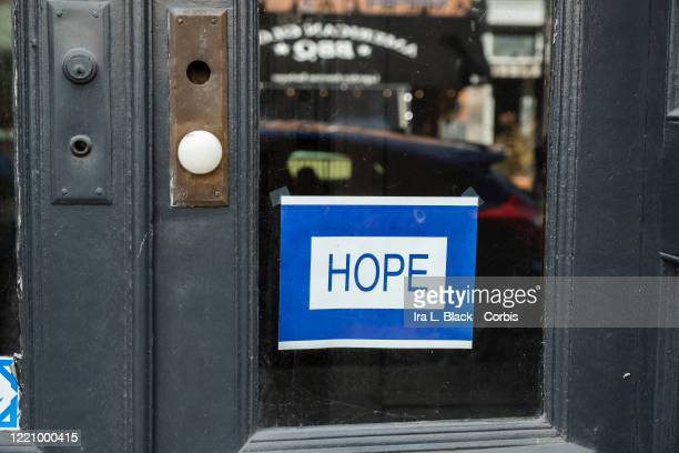 "Sign in a store window says, ""HOPE' expressing an inspirational message that many Americans are looking for during this time. On April 15, New York..."
