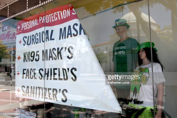 A sign in a window advertises face masks for sale on May 25 2020 in Westwood California Government guidelines encourage wearing a mask in public with...