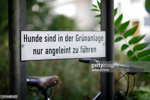 Sign in an urban green area indicates that dogs should be leashed on August 08, 2018 in Berlin, Germany.