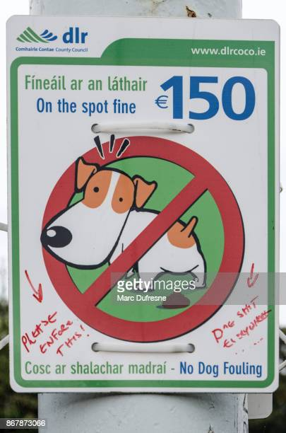 sign in dalkey ireland asking to scoop poop dog with handwriting on it saying to enforce the law - dalkey stock pictures, royalty-free photos & images