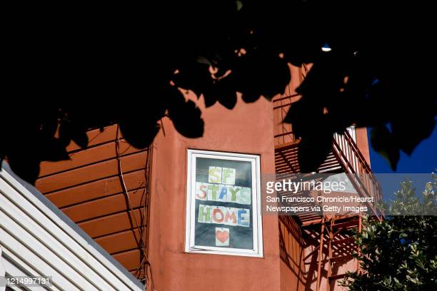 A sign in Erin Cox's window reads SF Stays Home near Dolores Park in San Francisco Calif Wednesday March 25 2020 Seven counties in the Bay Area have...