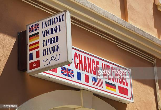 sign in five languages above money exchange shop