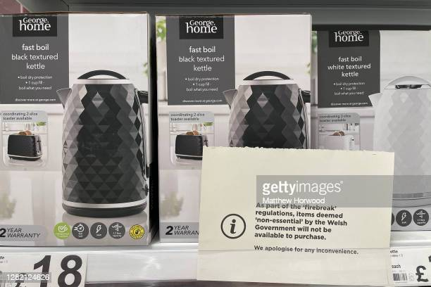 A sign in front of a kettle in a Cardiff Bay ASDA store saying the products cannot be sold due to 'firebreak' regulations on October 25 in Cardiff...