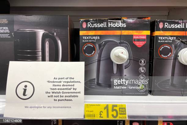 A sign in front of a kettle in an ASDA store in Coryton saying the products cannot be sold due to 'firebreak' regulations on October 25 in Cardiff...