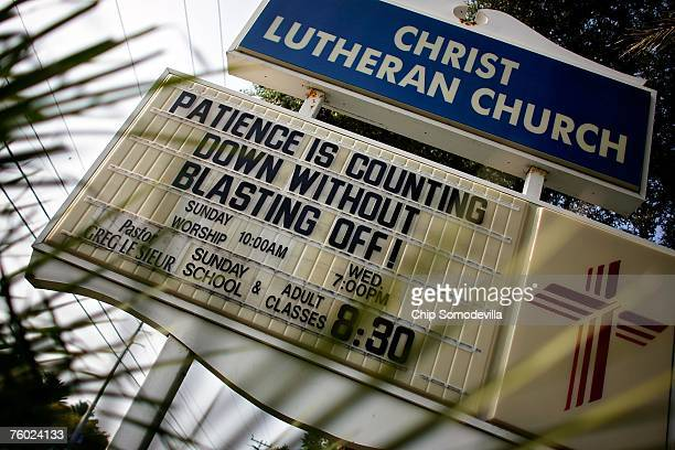 A sign in front of Christ Lutheran Church promotes the virtues of patience ahead of the launch of Space Shuttle Endeavour August 8 2007 in Cocoa...