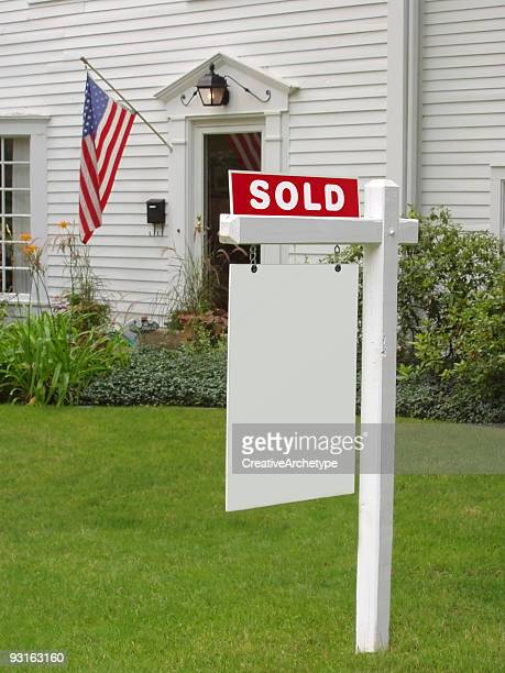 sold sign in front of mansion - estate agent sign stock pictures, royalty-free photos & images