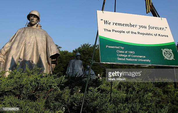A sign in front of statues at the Korean War Memorial reads We Remember You Forever on June 24 2010 in Washington DC Sixty years ago today North...