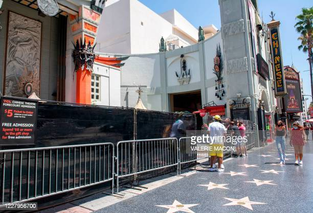 A sign in front of the TCL Chinese theatre advertises the price of the visit to view celebrities handprints in the courtyard on Hollywood Blvd August...