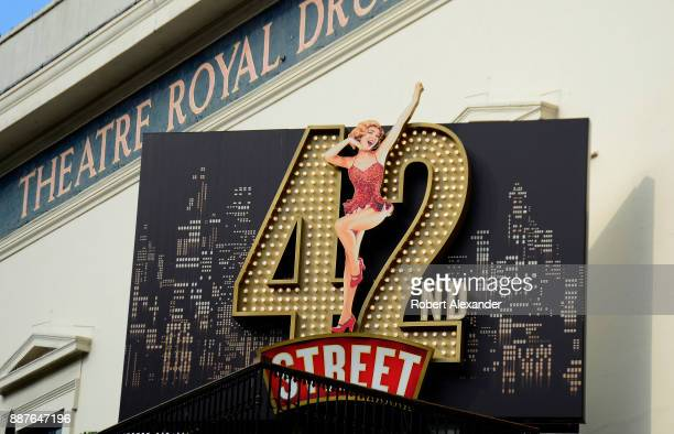 A sign in front of the Theatre Royal Drury Lane in London England advertises the theater's current show the American musical '42nd Street' The...