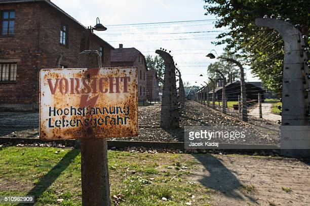 A sign in German reads 'Careful HighVoltage Danger' at the former electrified perimeter fence at the Auschwitz II memorial and former concentration...