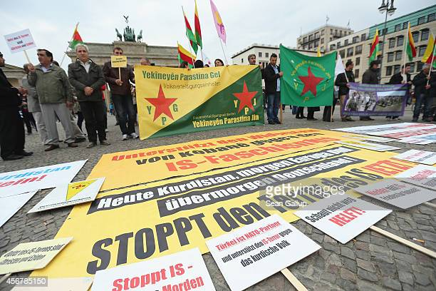 A sign in German reads Stop IS Terror Now at a rally by expatriateKurds who were protesting against the ongoing violence by militias of the Islamic...