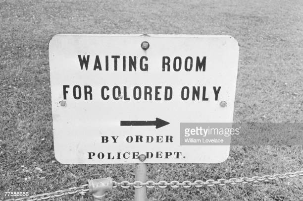 Sign in Jackson, Mississippi which reads 'Waiting Room For Colored Only by order Police Dept.', 25th May 1961.