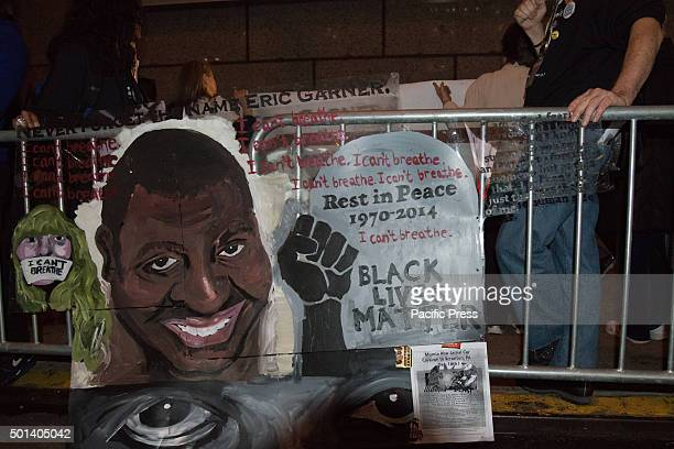 A sign in memory of Eric Garner hangs on a police barricade opposite the Ziegfeld Theater At the premiere of his new film 'Hateful Eight' at the...
