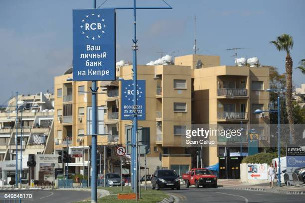 A sign in Russian advertises for Russianowned RCB bank on March 8 2017 in Limassol Cyprus Cyprus has largely recovered from its 20122013 economic...