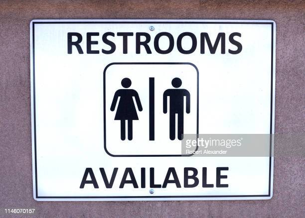 A sign in Santa Fe New Mexico identifies the location of public restrooms