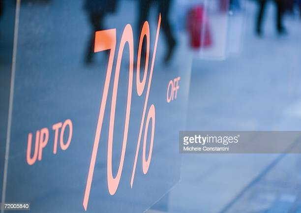 sign in shop window reading up to 70% off - typographies stock photos and pictures