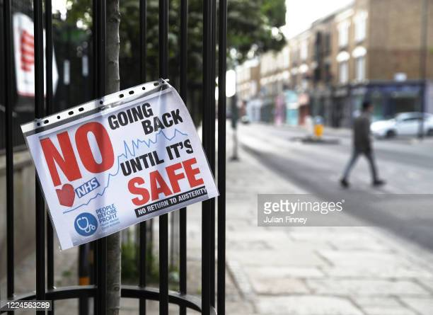 Sign in Stoke Newington warning people against going back to work too soon on May 13, 2020 in London, England. The prime minister announced the...