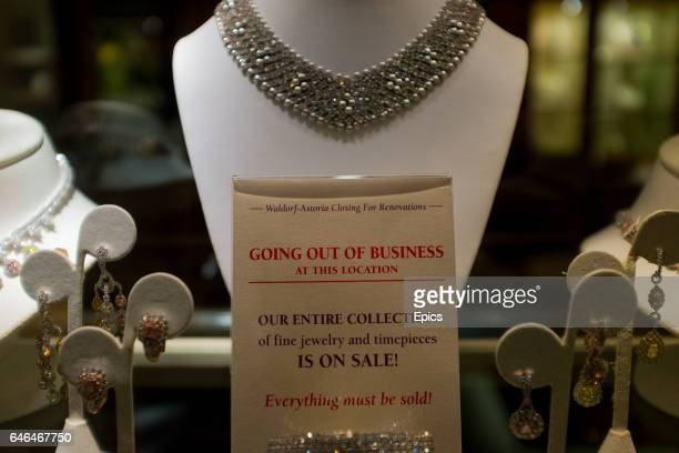 A sign in the display case of a jewelry store inside the Waldorf Astoria hotel Manhattan New York letting customers know of the closing down sale the...