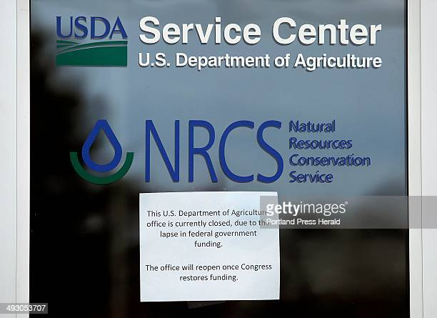 A sign in the door of the US Department of Agriculture field office at 306 Route 1 in Scarborough photographed Friday October 4 informs customers...