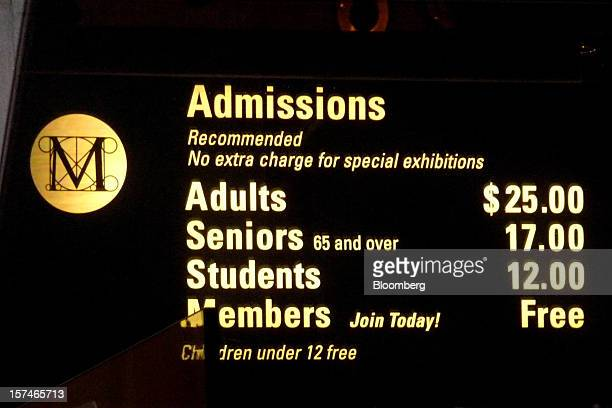 A sign in the lobby of the Metropolitan Museum of Art listing recommended admission fees is shown in New York US on Friday Nov 23 2012 Two New...